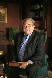 Sproul R C image seated with Bible