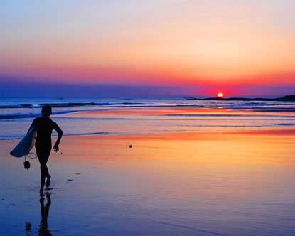 portugal surfing sunset