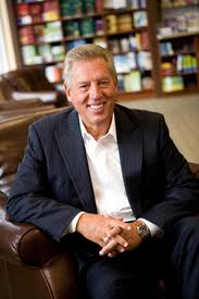 John C Maxwell seated