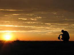 prayer in field w sunset