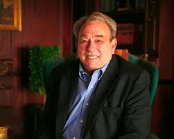 R.C. Sproul sitting in green chair