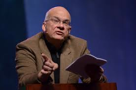 Tim Keller praching w bible image