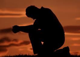 praying man on one knee image