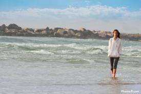 Lady Walking alone on the beach