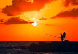 sunset two men fishing