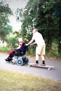 elderly couple on skateboard