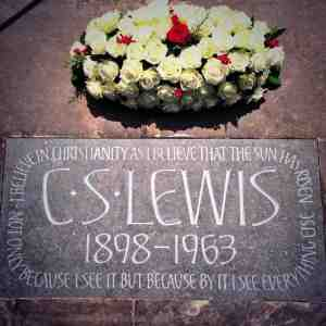 C.S. Lewis on Stone with Flowers